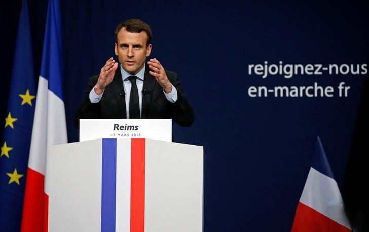 Emmanuel Macron, head of the political movement En Marche !, or Onwards !, and candidate for the 2017 presidential election, attends a meeting in Reims, France March 17, 2017.  REUTERS/Pascal Rossignol