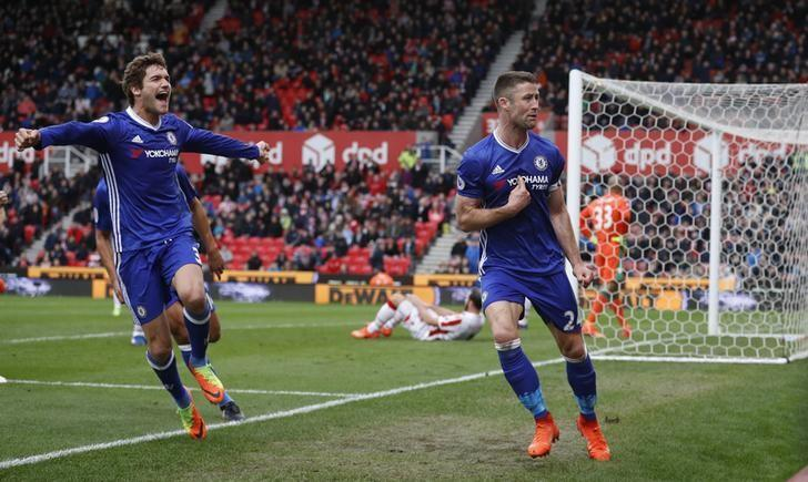 Britain Football Soccer - Stoke City v Chelsea - Premier League - bet365 Stadium - 18/3/17 Chelsea's Gary Cahill celebrates with Marcos Alonso after scoring their second goal  Reuters / Phil Noble Livepic