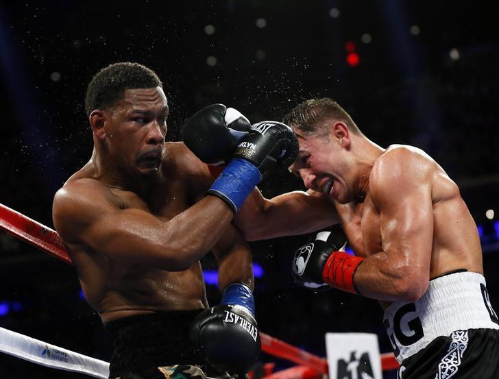 Mar 18, 2017; New York City, NY, USA;   Daniel Jacobs and Gennady Golovkin  exchange punches during middleweight world championship fight at Madison Square Garden. Mandatory Credit: Noah K. Murray-USA TODAY Sports