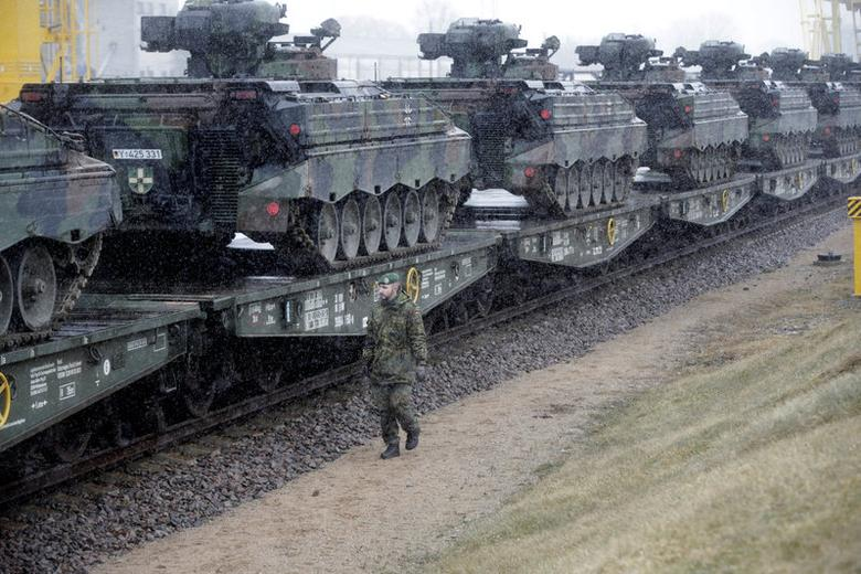 A German army soldier walks past Marder infantry fighting vehicles at the railway station in Sestokai, Lithuania, February 24, 2017. REUTERS/Ints Kalnins