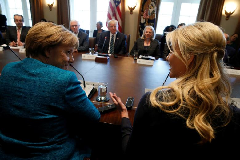 Germany's Chancellor Angela Merkel (L) and Ivanka Trump speak during a roundtable discussion between U.S. President Donald Trump and German and U.S. business leaders on vocational training at the White House in Washington, U.S. March 17, 2017. REUTERS/Jonathan Ernst