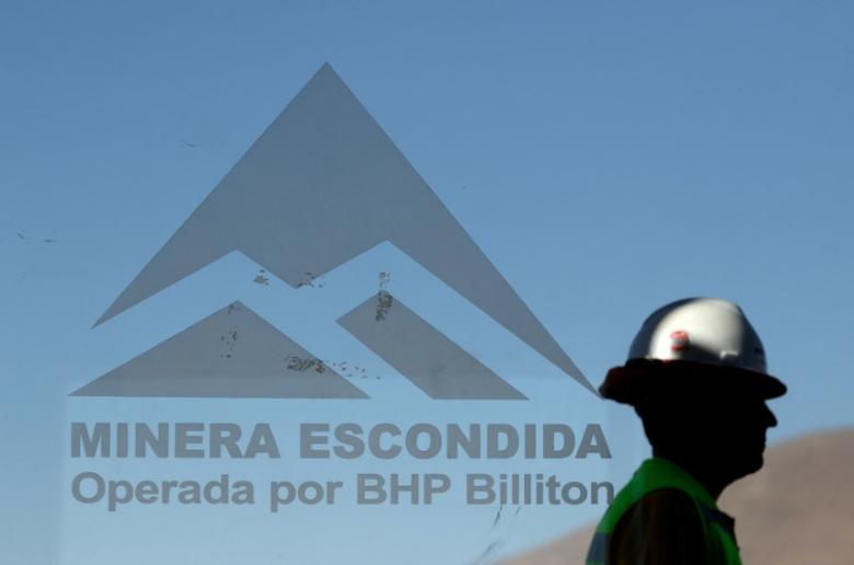 FILE PHOTO -  A worker from BHP Billiton's Escondida, the world's biggest copper mine, is seen outside the company gates during a strike, in Antofagasta, Chile February 10, 2017. REUTERS/Juan Ricardo/File Photo