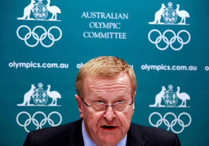 John Coates, President of the Australian Olympic Committee (AOC), reacts as he announces the findings of a probe into the conduct of Australian swimming team members in the run-up to the 2012 London Games, at a media conference in Sydney August 23, 2013. REUTERS/David Gray/File Photo