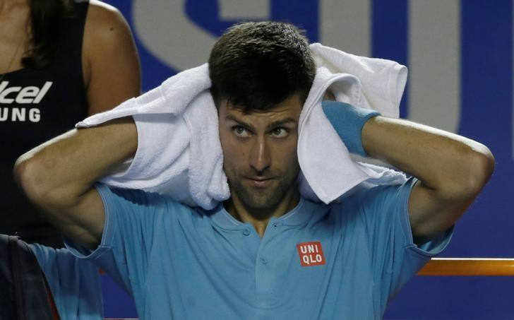 Tennis - Mexican Open - Men's Singles - Quarter-Final - Acapulco, Mexico - 02/03/17 - Serbia's Novak Djokovic rests during the match against Australia's Nick Kyrgios. REUTERS/Henry Romero