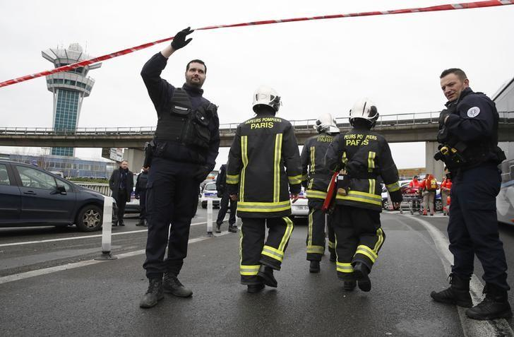 Emergency services arrive at Orly airport southern terminal after a shooting incident near Paris, France March 18, 2017.  REUTERS/Christian Hartmann - RTX31LA7
