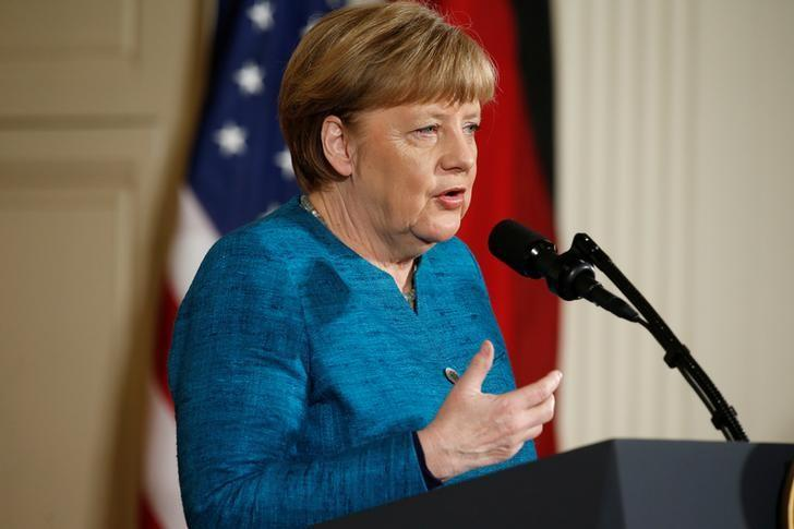 German Chancellor Angela Merkel speaks during a joint news conference with U.S. President Donald Trump in the East Room of the White House in Washington, U.S., March 17, 2017.  REUTERS/Joshua Roberts/Files