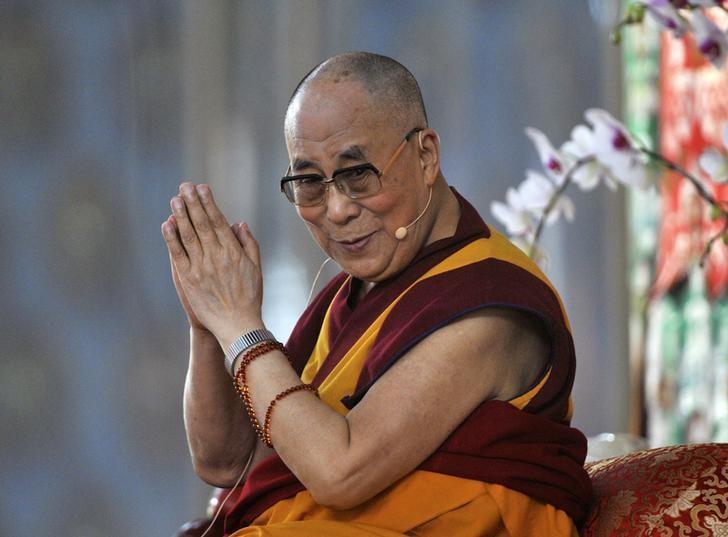 Exiled Tibetan spiritual leader, the Dalai Lama, gestures as he speaks to his followers during the Jangchup Lamrim teaching session at the Gaden Jangtse Thoesam Norling Monastery in Mundgod in Karnataka December 23, 2014. REUTERS/Abhishek N. Chinnappa/Files