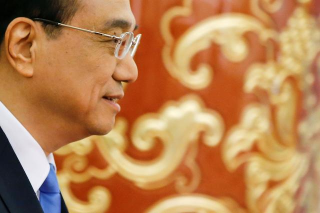 FILE PHOTO: China's Premier Li Keqiang arrives for a news conference after the closing ceremony of China's National People's Congress (NPC) at the Great Hall of the People in Beijing, China, March 15, 2017. REUTERS/Damir Sagolj/File Photo