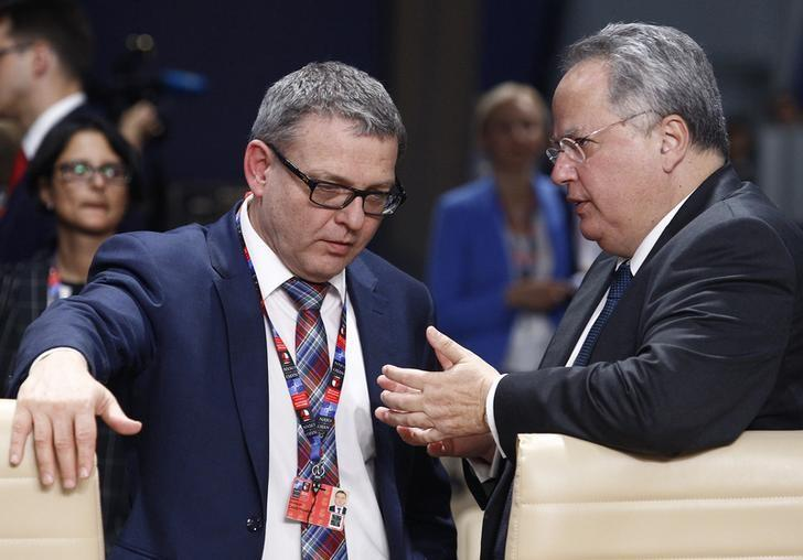 Greek Foreign Minister Nikos Kotzias (R) speaks to Czech Republic's Foreign Minister Lubomir Zaoralek at the NATO Summit in Warsaw, Poland July 8, 2016. REUTERS/Jerzy Dudek