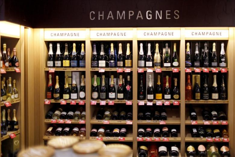 Bottles of champagne are displayed December 21, 2016 at a Nicolas French wine specialist store in Paris, France.  Picture taken December 21, 2016.  REUTERS/Charles Platiau