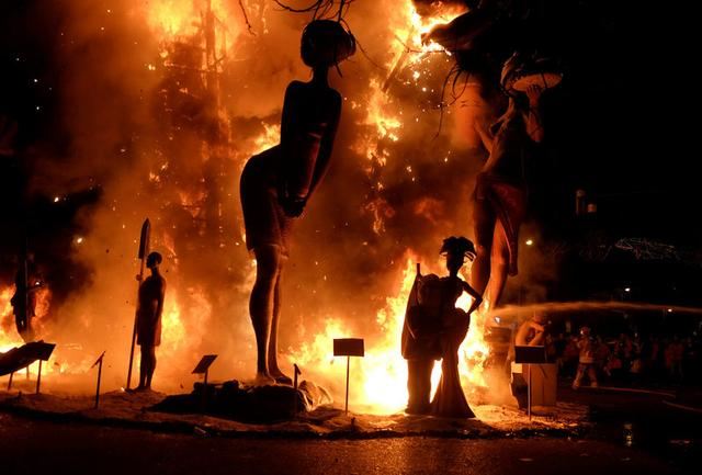 Figures of a Fallas monument are burning during the finale of the Fallas festival, which welcomes spring and commemorates Saint Joseph's Day, in Valencia early March 20, 2017. REUTERS/Heino Kalis