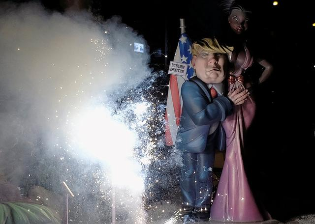 A figure depicting U.S. President Donald Trump stands next to lit fireworks during the finale of the Fallas festival, which welcomes spring and commemorates Saint Joseph's Day, in Valencia early March 20, 2017. REUTERS/Heino Kalis