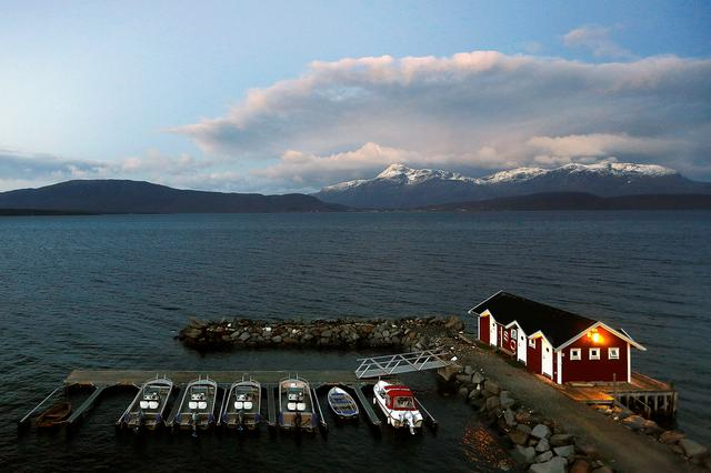 General view of a small harbour and snow-capped mountains in Bals-Fiord, north of the Arctic Circle, near the village of Mestervik in northern Norway. REUTERS/Yannis Behrakis