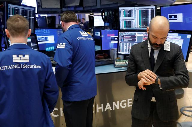 Traders work on the floor of the New York Stock Exchange (NYSE) shortly after the opening bell in New York, U.S., March 20, 2017. REUTERS/Lucas Jackson