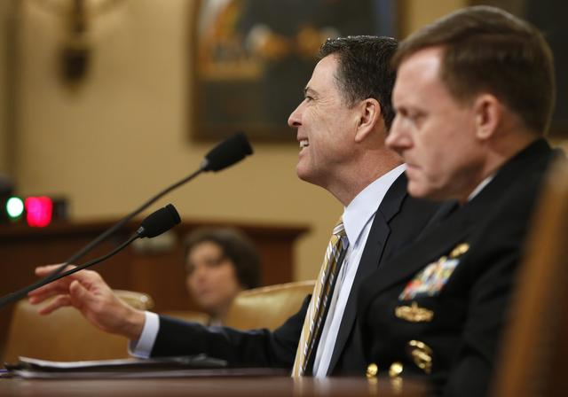 FBI Director James Comey (L) and National Security Agency Director Mike Rogers testify before the House Intelligence Committee hearing into alleged Russian meddling in the 2016 U.S. election on Capitol Hill in Washington, U.S., March 17, 2017. REUTERS/Joshua Roberts