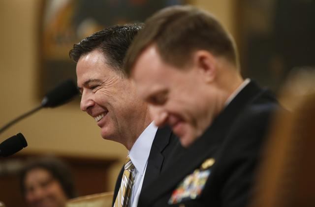 FBI Director James Comey (L) and National Security Agency Director Mike Rogers smile during the House Intelligence Committee hearing into alleged Russian meddling in the 2016 U.S. election on Capitol Hill in Washington, U.S., March 17, 2017. REUTERS/Joshua Roberts