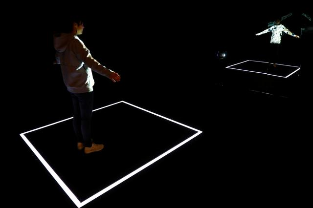 A staff member uses a projector to display the knitting pattern at the Adidas Knit for You store in Berlin, Germany March 7, 2017. Picture taken March 7, 2017. REUTERS/Fabrizio Bensch     TPX IMAGES OF THE DAY