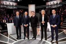 French presidential election candidates (LtoR) Francois Fillon, Emmanuel Macron, Jean-Luc Melenchon, Marine Le Pen and Benoit Hamon, pose before a debate organised by French private TV channel TF1 in Aubervilliers, outside Paris, France, March 20, 2017. REUTERS/Patrick Kovarik/Pool