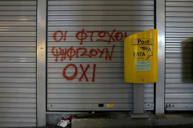 A slogan reads '' The poor vote for NO'' next to a mailbox outside a closed Hellenic Post branch in Athens, Greece, March 20, 2017. REUTERS/Alkis Konstantinidis