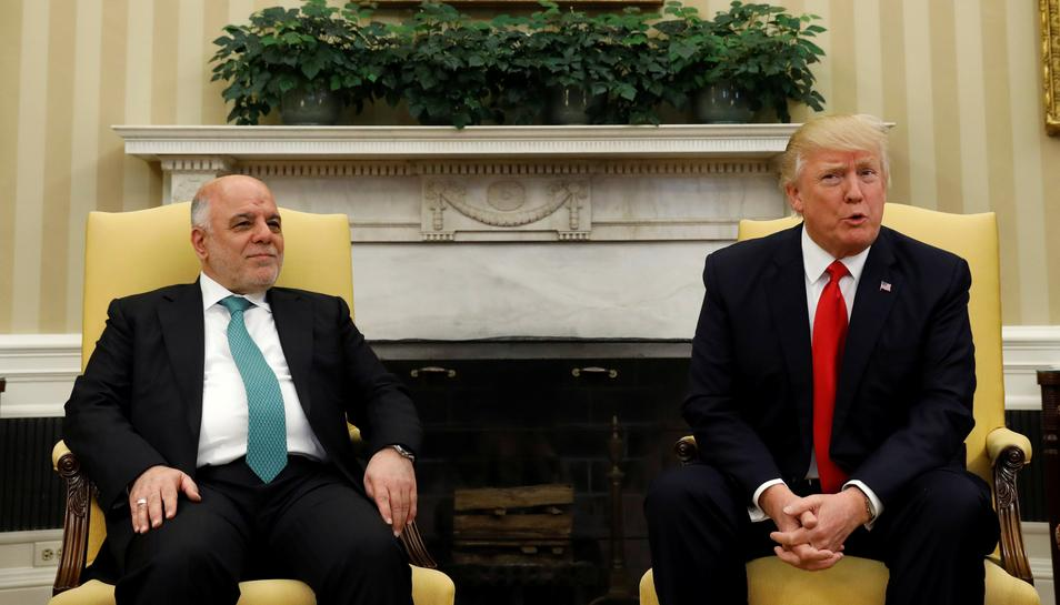 photo image Iraqi leader thanks Trump for removing Iraq from travel ban list