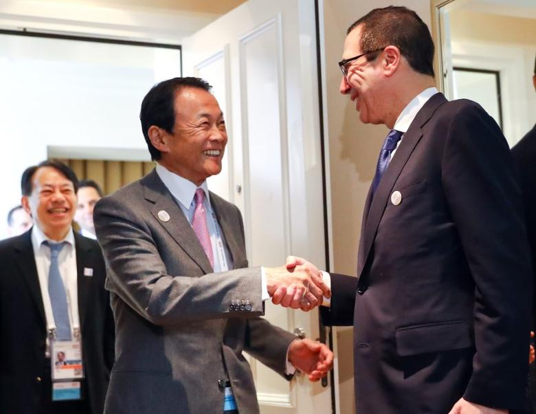U.S. Treasury Secretary Steve Mnuchin and Japan's Finance Minister Taro Aso meet for bilateral talks at the G20 Finance Ministers and Central Bank Governors Meeting in Baden-Baden, Germany, March 17, 2017.   REUTERS/Kai Pfaffenbach