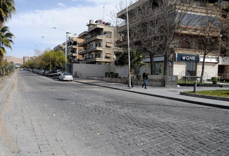 People walk at the Abbasiyin area in the east of the capital Damascus, in this handout picture provided by SANA on March 21, 2017, Syria. SANA/Handout via REUTERS