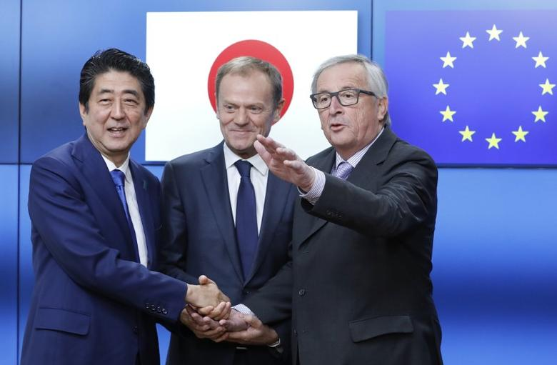Japanese Prime Minister Shinzo Abe meets with EU Commission President Jean-Claude Juncker (R) and EU Council President Donald Tusk at the EU headquarters in Brussels, Belgium, March 21, 2017.       REUTERS/Yves Herman