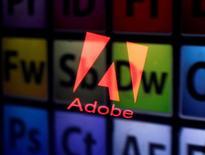 Adobe et Microsoft à suivre mardi à Wall Street. Les compagnies ont annoncé lundi une alliance visant à faciliter l'interaction entre leurs produits, afin de mieux rivaliser avec salesforce.com et Oracle. /Photo d'archives/REUTERS/Dado Ruvic