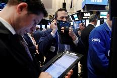 Traders work on the floor of the New York Stock Exchange (NYSE) shortly after the opening bell in New York, U.S., March 21, 2017.  REUTERS/Lucas Jackson