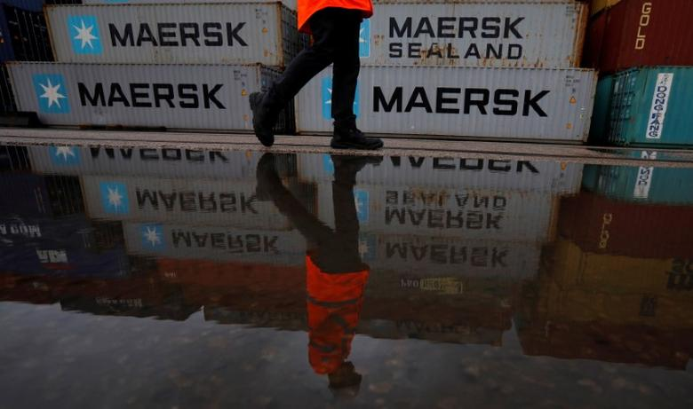 FILE PHOTO:  A man walks past empty Maersk shipping containers at Peel Ports container terminal in Liverpool, Britain, December 9, 2016.      REUTERS/Phil Noble/File Photo
