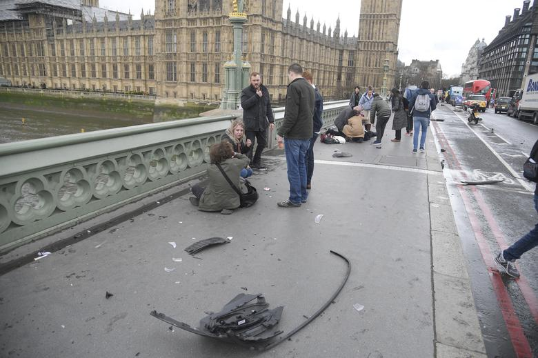 Injured people are assisted after an incident on Westminster Bridge in London. REUTERS/Toby Melville