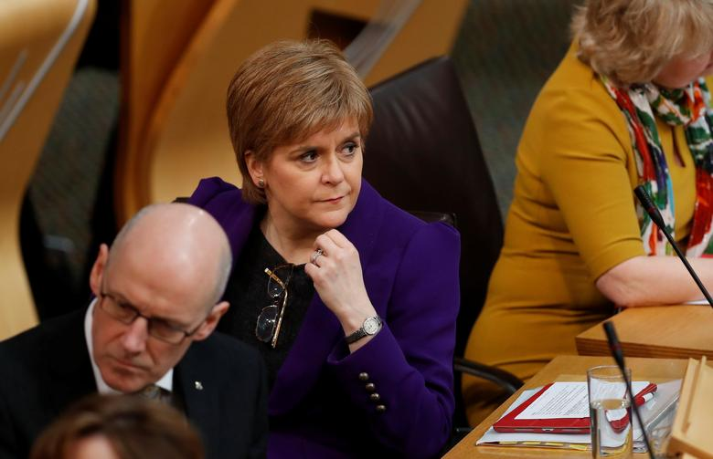 Scotland's First Minister Nicola Sturgeon and Deputy First Minister John Swinney listen to the referendum debate in Edinburgh, Scotland, Britain March 22, 2017. REUTERS/Russell
