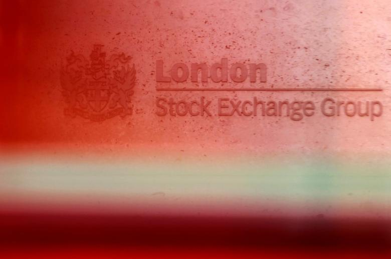 A red London bus passes the Stock Exchange in London, Britain, February 9, 2011.   REUTERS/Luke MacGregor/File Photo
