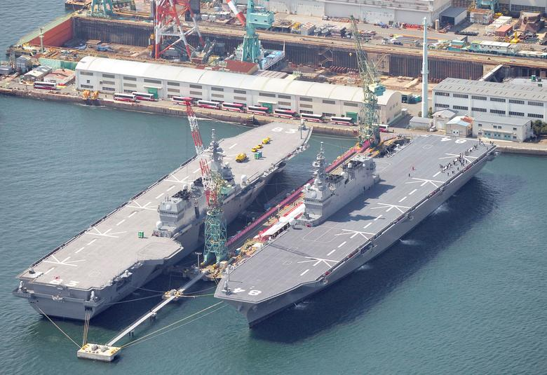 Japan Maritime Self-Defense Force's (JMSDF) latest Izumo-class helicopter carrier DDH-184 Kaga (R) is seen next to JMSDF's helicopter carrier Izumo in Yokohama, Japan, March 22, 2017, in this photo taken by Kyodo.  Mandatory credit Kyodo/via REUTERS