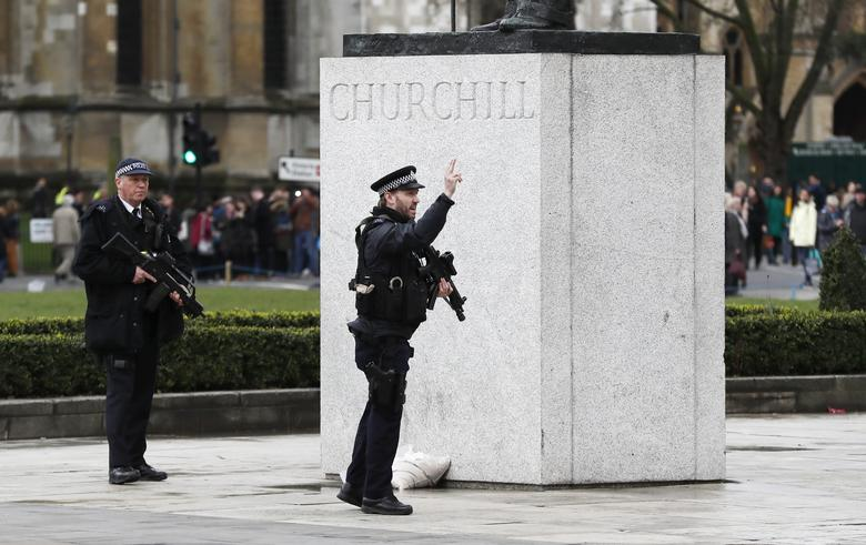 Armed police respond outside Parliament during an incident on Westminster Bridge. REUTERS/Stefan Wermuth