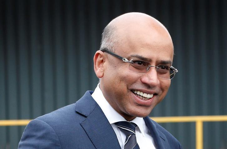 Liberty Steel's Sanjeev Gupta smiles outside their newly acquired Liberty Steel processing mill in Dalzell, Scotland, Britain April 8, 2016. REUTERS/Russell Cheyne/Files