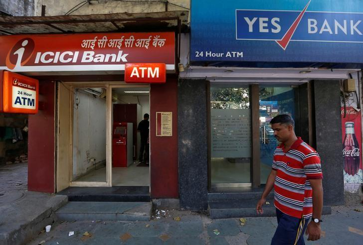 A man walks past ICICI Bank and Yes Bank automated teller machines (ATMs) in New Delhi, India, October 20, 2016. REUTERS/Adnan Abidi