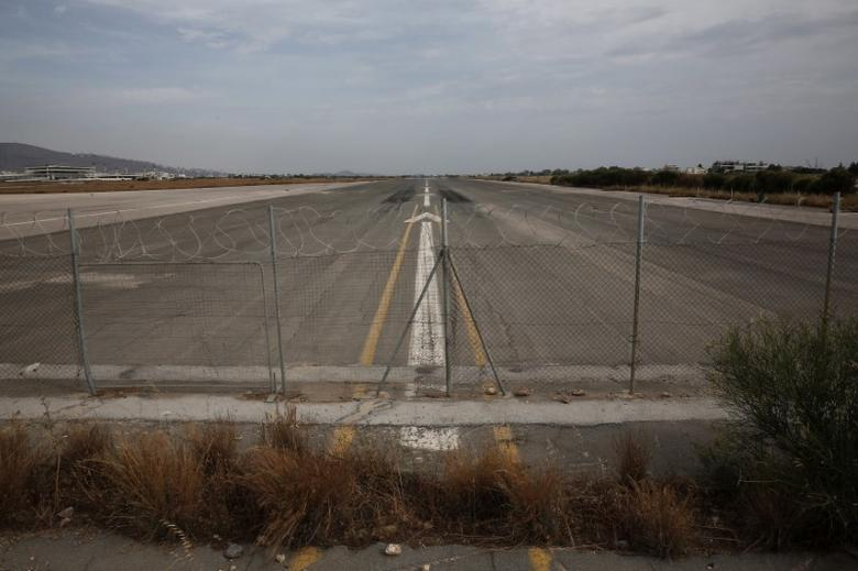 FILE PHOTO: A runway is seen at the former Athens International airport of Hellenikon June 17, 2014.  REUTERS/Yorgos Karahalis