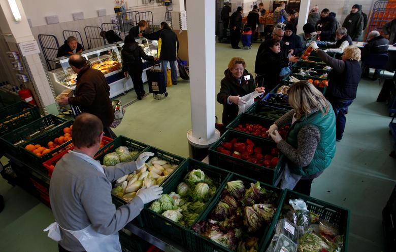 People receive food that is either too old or not looking nice enough for sale at the non-profit Dortmund food bank ''Dortmunder Tafel''  in the western German city of Dortmund March 20, 2013.  REUTERS/Ina Fassbender/Files