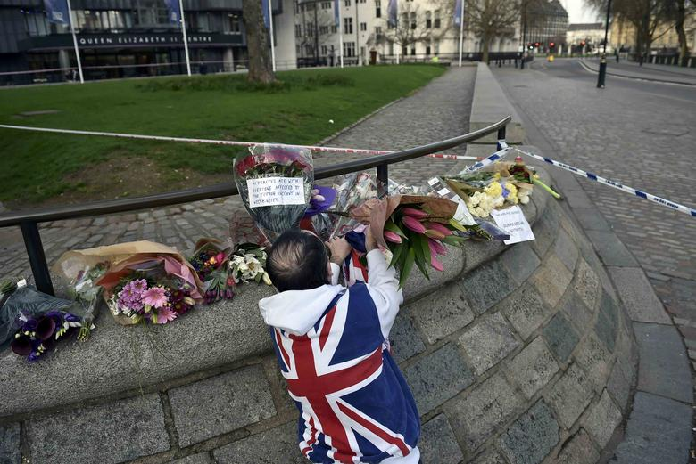 A man wears a Union Flag sweatshirt near the Houses of Parliament in Westminster the day after an attack, in London, Britain March 23, 2017.          REUTERS/Hannah McKay