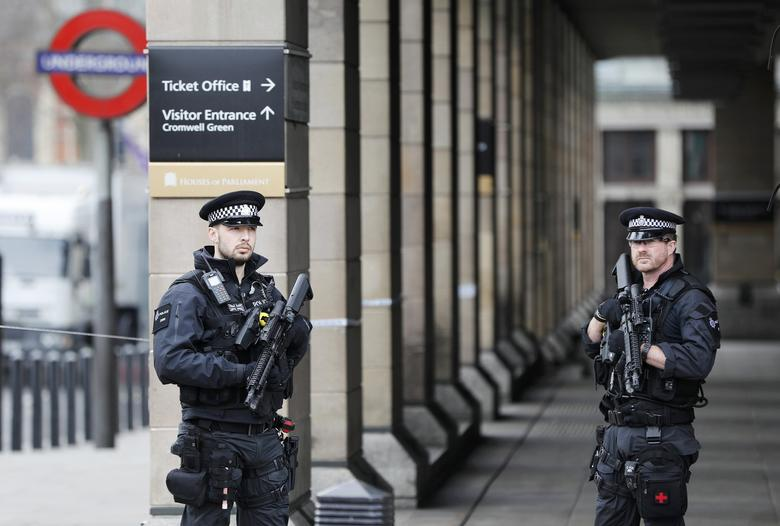 Armed police officers patrol outside Westminster underground station the morning after an attack in London, Britain, March 23, 2017.     REUTERS/Darren Staples