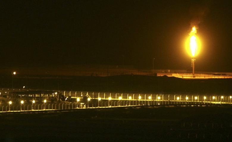 Shaybah oilfield complex is seen at night in the Rub' al-Khali desert, Saudi Arabia, November 14, 2007. REUTERS/ Ali Jarekji/File Photo