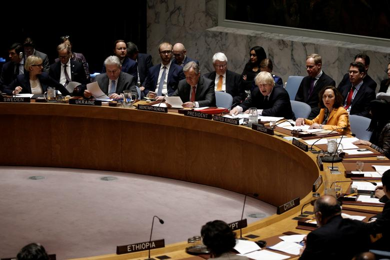 British Foreign Secretary Boris Johnson sits next to United Nations Secretary General Antonio Guterres as Johnson chairs a U.N. Security Council meeting on South Sudan at U.N. headquarters in New York City, New York, U.S. March 23, 2017. REUTERS/Mike Segar