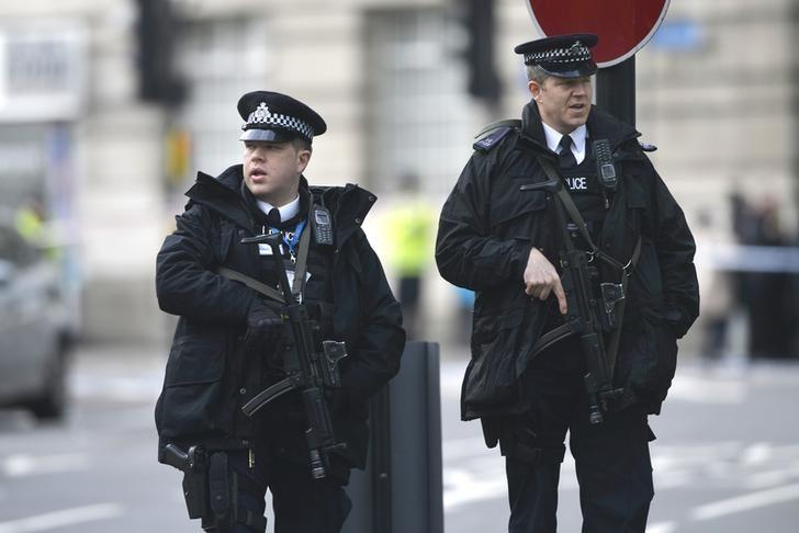 Armed police respond outside Parliament during an incident on Westminster Bridge in London, Britain March 22, 2017.    REUTERS/Hannah McKay