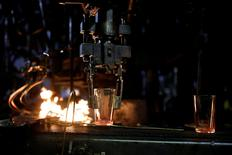 FILE PHOTO: Glasses go under fire during production at the Duralex International glass factory in La Chapelle-Saint-Mesmin, near Orleans, France March 10, 2017. REUTERS/Benoit Tessier/File Photo