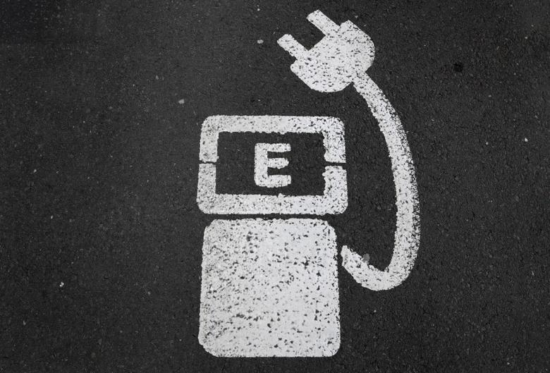 FILE PHOTO - A battery charger sign for electric cars is painted on the ground of a parking ground near the soccer stadium in Wolfsburg, Germany, in this April 6, 2016 file photo.    REUTERS/Kai Pfaffenbach/File Photo