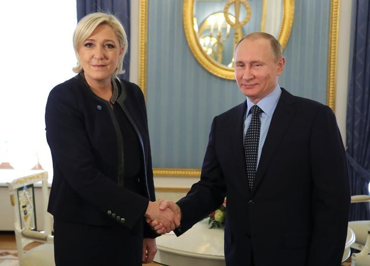 Russian President Vladimir Putin shakes hands with Marine Le Pen, French National Front (FN) political party leader and candidate for the French 2017 presidential election, during their meeting in Moscow, Russia March 24, 2017. Sputnik/Mikhail Klimentyev/Kremlin via REUTERS