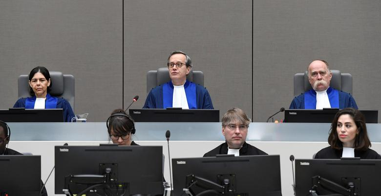 Presiding Judge Marc Perrin de Brichambaut, Judge Olga Herrera-Carbuccia, and Judge Peter Kovacs in the courtroom of the International Criminal Court, as the ICC delivers its order for reparations to victims in the case The Prosecutor v. Germain Katanga at a public hearing, in The Hague, Netherlands March 24, 2017. REUTERS/Toussaint Kluiters