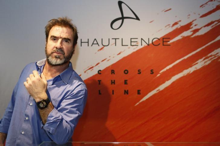 Hautlence ambassador Eric Cantona poses during the ''Salon International de la Haute Horlogerie'' (SIHH) watch fair in Geneva, Switzerland, January 18, 2016.  REUTERS/Pierre Albouy/Files