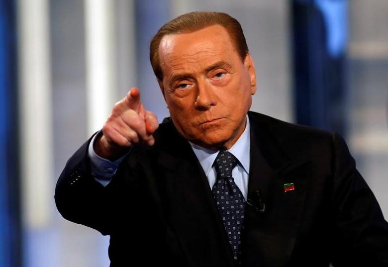 Italy's former Prime Minister Silvio Berlusconi gestures as he attends television talk show ''Porta a Porta'' (Door to Door) in Rome, Italy, November 30, 2016. REUTERS/Remo Casilli